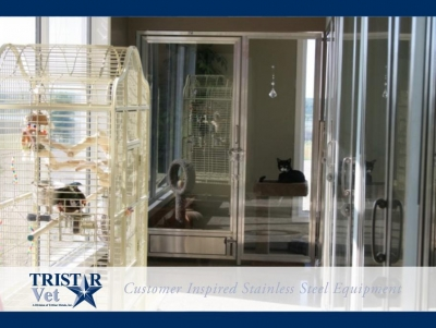 TriStar Vet cat condo photo: A beautiful and open yet cozy cat condo design in stainless steel and glass
