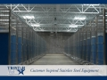 TriStar Vet kennel photo: A row of blue Starlite color panels warm up a large kennel floor plan