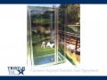 TriStar Vet kennel photo: A comfy overnight boarding area with stainless steel and glass doors