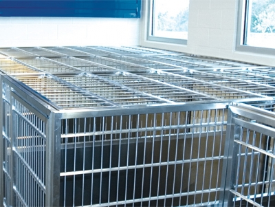 TriStar Vet treatment equipment photo: Our stainless steel kennel cover keeps leaping patients in place